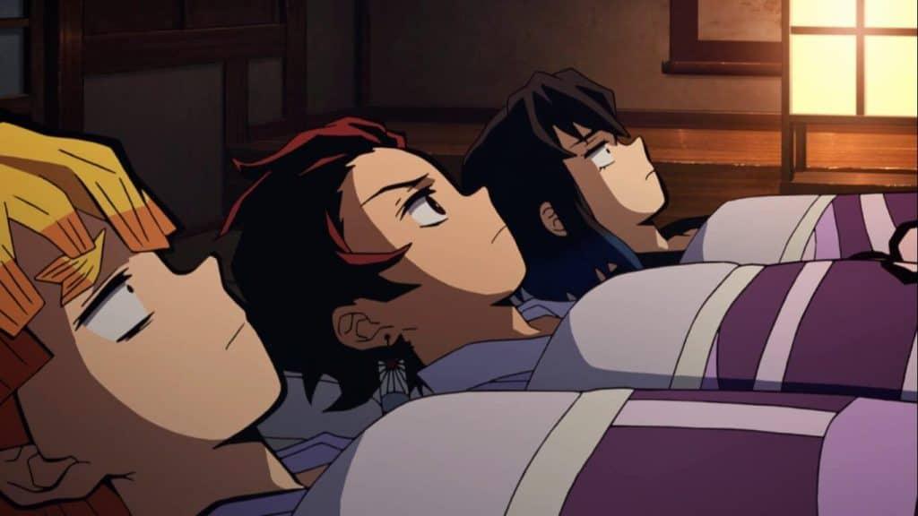 Os tres protagonistas de Kimetsu deitados num episódio de Demon Slayer