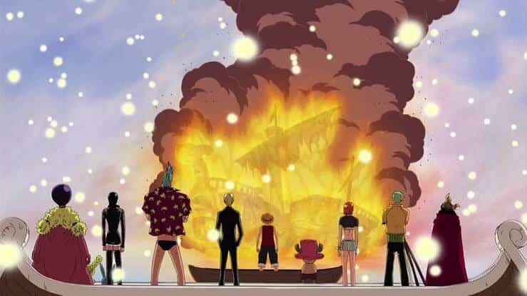 Personagens do Elenco principal de One Piece vendo o barco pegar fogo