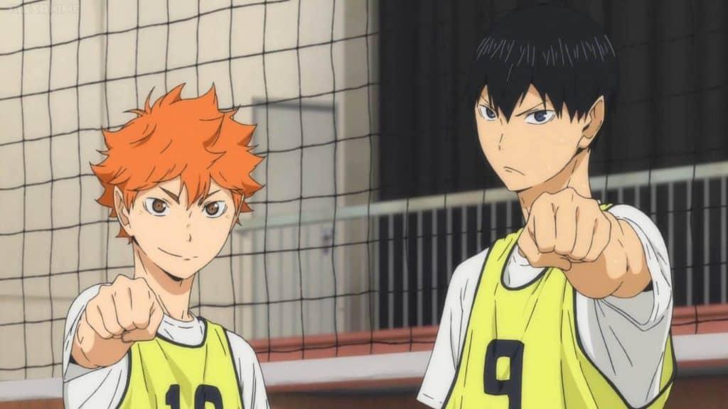 Hinata e Kageyama com as mãos para frente em Haikyuu