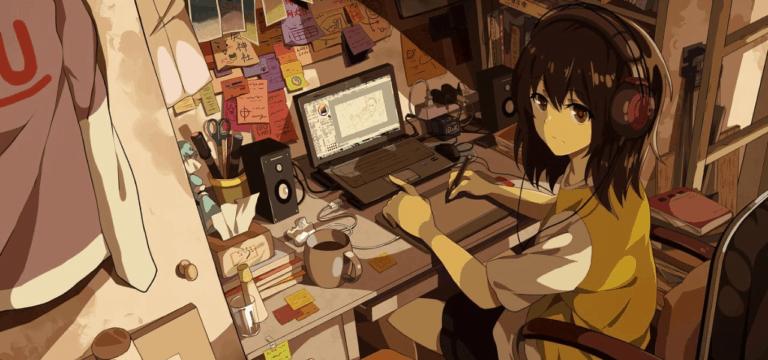 Garota sentada a frente de seu computador