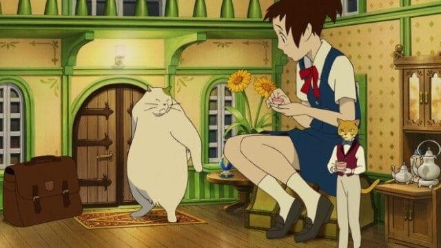 haru e outros personagens dentro de uma pequena casa no filme o reino dos gatos