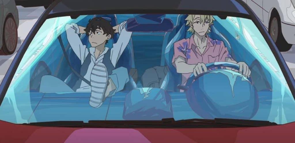os protagonistas dentro de um carro