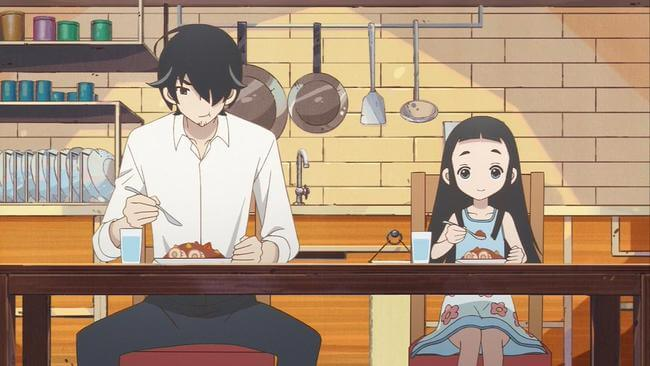 pai e filha comendo juntos na mesa de jantar