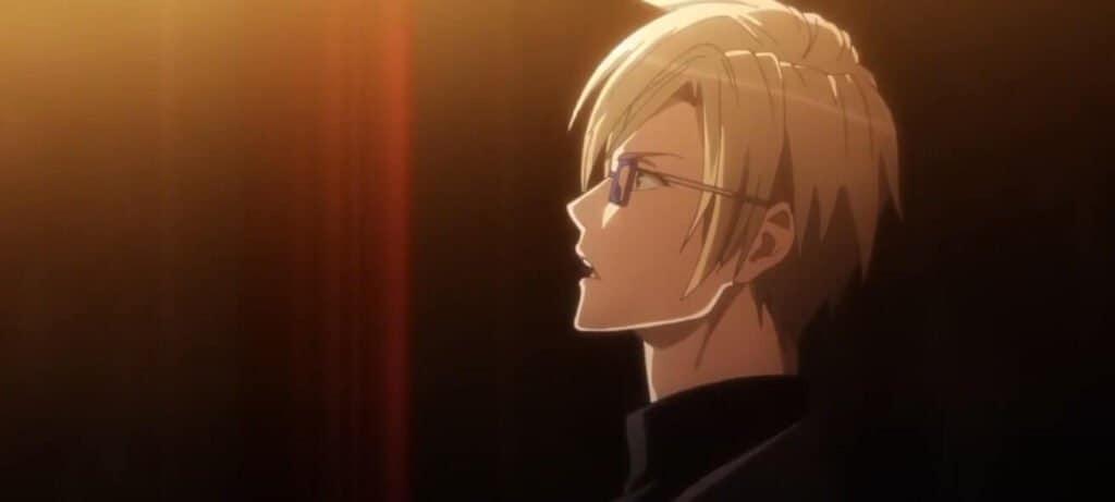 personagem loiro de óculos de a3 olhando levemente para cima e falando, para esquerda