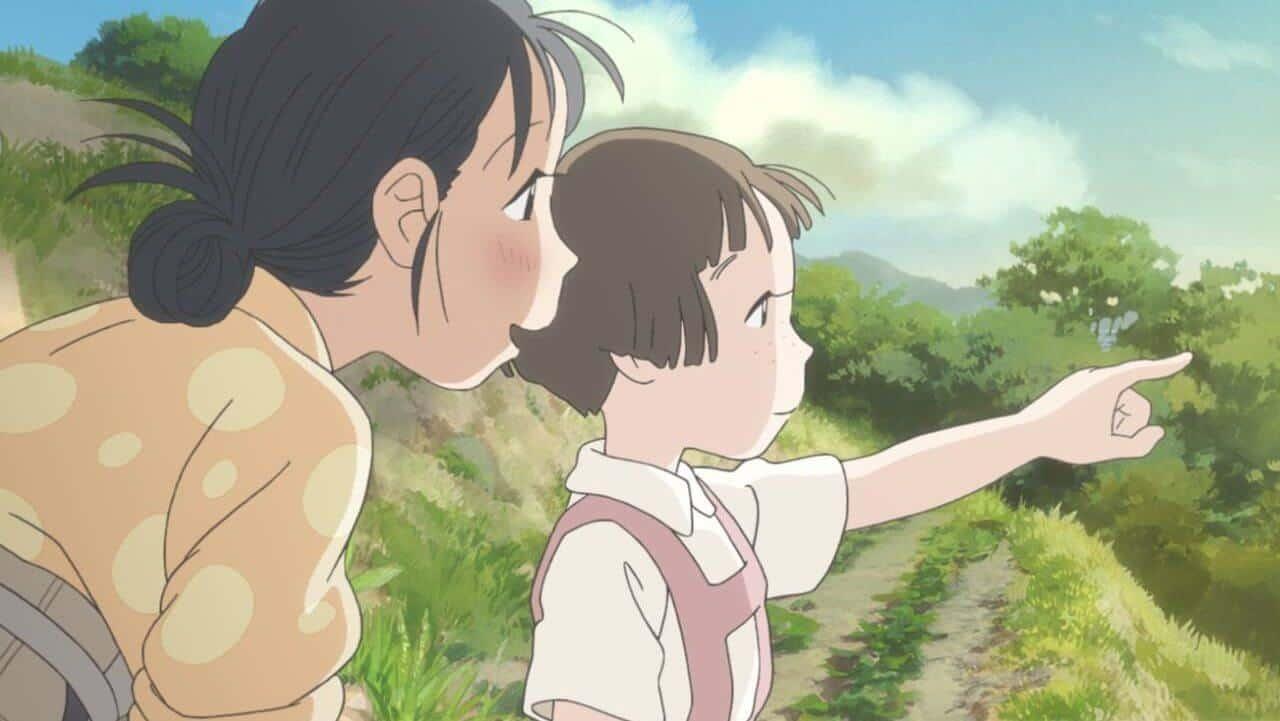 garota apontando para o horizonte com mulher mais velha ao lado