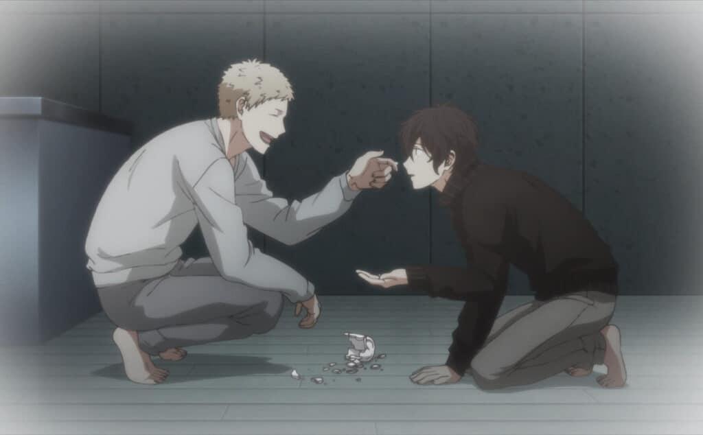 Akihiko pegando os pedaços da xicára que o Uenoyama quebrou