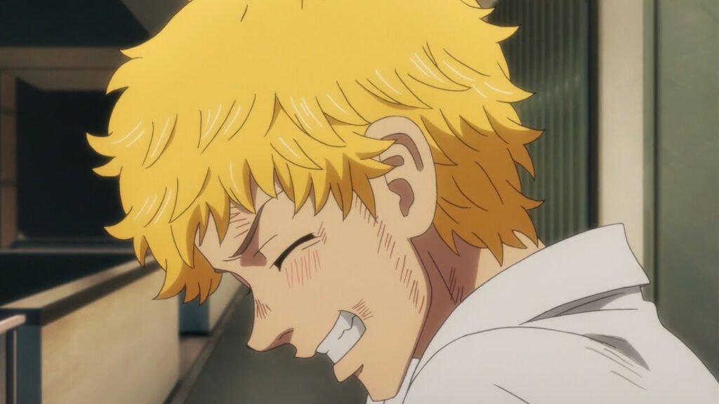 Takemichi sorrindo em uma expressão muito feliz