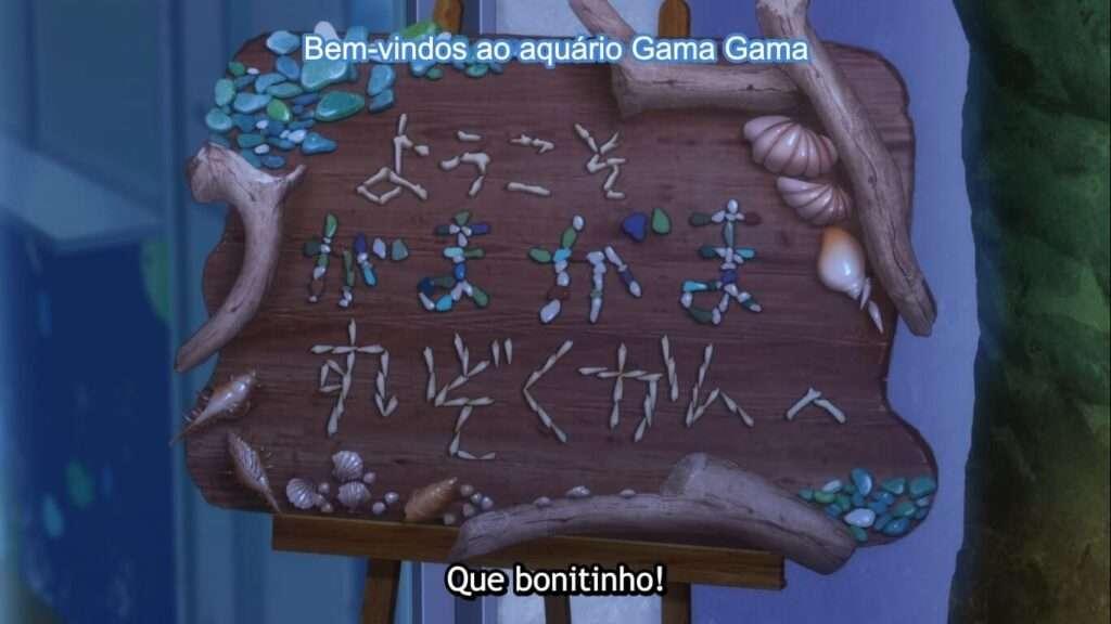 Placa artesanal da entrada do aquário, escrito: Bem vindo ao aquário Gama Gama.