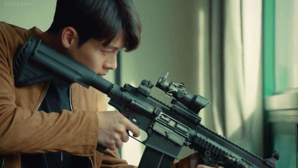 Imagem de Yoo Ji segurando uma arma