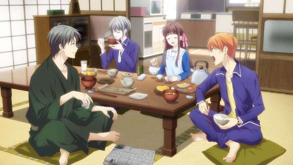 Imagem de Kyo, Yuiki e Shigure Souma se alimentando com Tooru