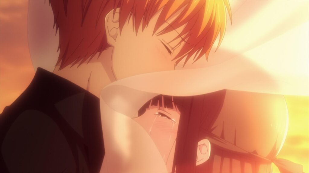 Kyo e Tooru se abraçam ao entardecer em Fruits Basket