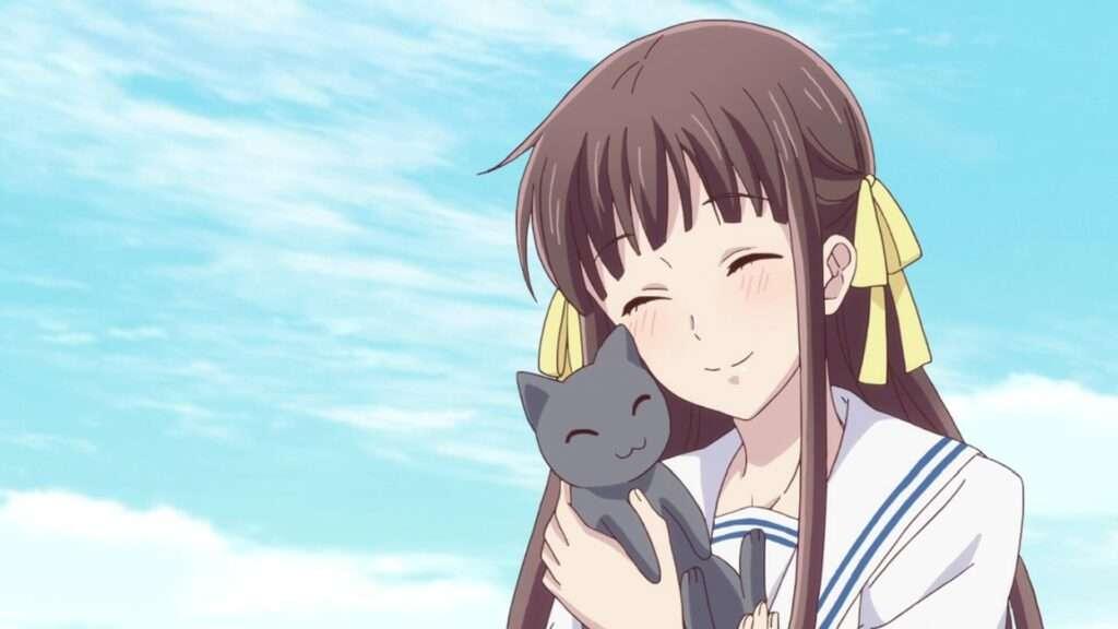 Imagem de Tooru abraçando um gatinho cinza